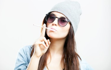 Hipster teenage girl smoking cigarette