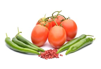Tomatoes, chilli and cayenne pepper on white background