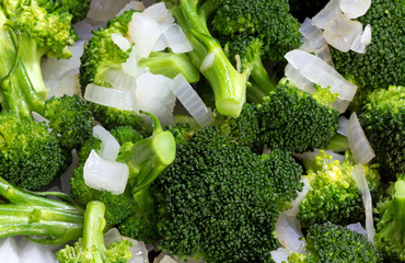 Close view of cooking broccoli and onions