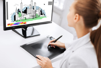 architect with drawing tablet in office