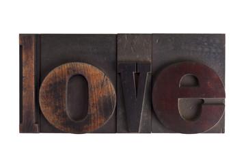 love, word written in letterpress type blocks