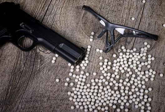 airsoft gun with glasses