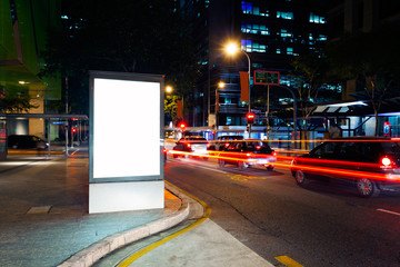 Advertising light boxes in the city at night Fotomurales