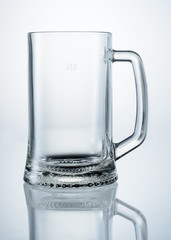 Empty beer mug with reflection isolated. With clipping path