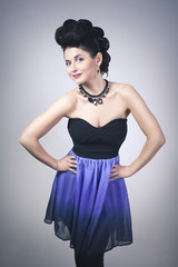 Attractive young woman with professional make-up and hair style.
