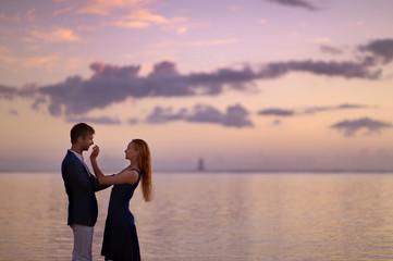 Beautiful romantic couple on a tropical beach