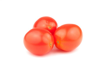 Three small cherry tomatos