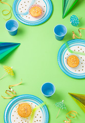 Boy birthday green table setting with party gadgets