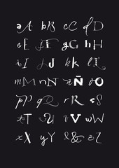 Calligraphic hand written uppercase and lowercase black and whit