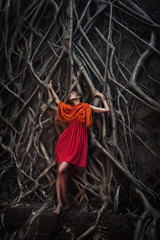 girl in tree roots