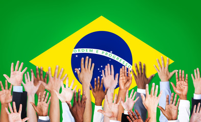 Group of Multi-Ethnic Hands with Flag of Brazil