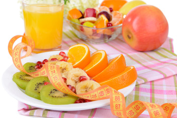 Sweet fresh fruits on plate on table close-up