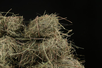 Hay, on dark background