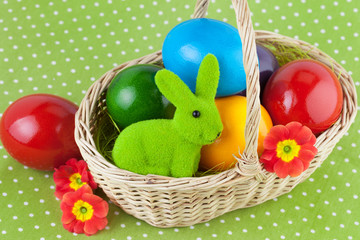Easter Basket with Eggs on Green Polka Dot Tablecloth