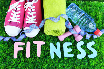 Fitness and healthy life. Conceptual photo. Gumshoes, towel,