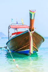Longtail boat on the sea tropical beach.