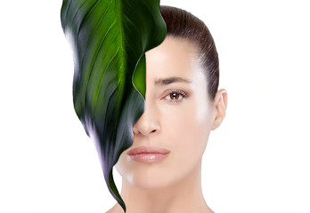 Beautiful Spa Girl with Leaf on Her Face. Skincare concept