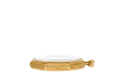 Vintage ornate gold color pocket watch resting on its back