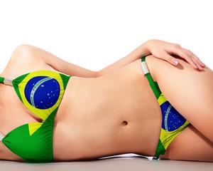 Young woman wearing brazil bikini swimsuit