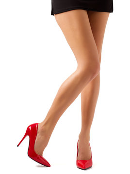 Perfect women legs in red shoes