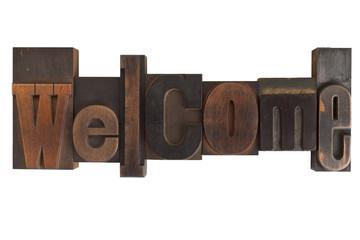 welcome, word written in vintage printing blocks