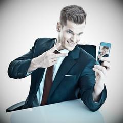 Geschäftsmann macht ein Selfie