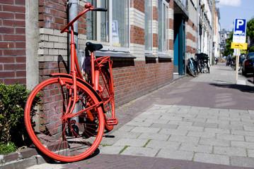 Foto op Plexiglas Fiets red bicycle parked