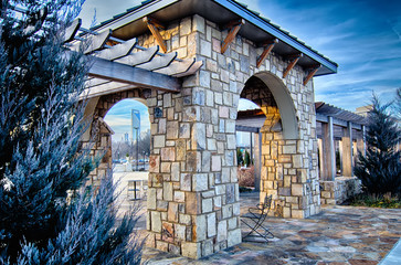 Wall Mural - cultured stone terrace trellis details near park in a city