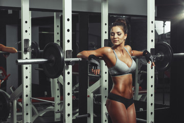 Wall Mural - Woman resting after lifting barbell