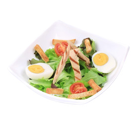 Caesar salad with eggs and tomatoes.