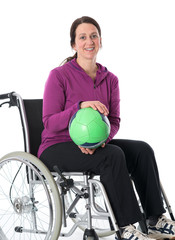 woman in wheelchair is doing sports