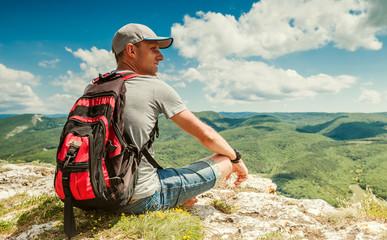 Mountain hiker relax on the top of mountain, Crimea, Ukraine