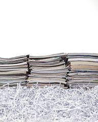 Stacked Magazines and Shredded Paper