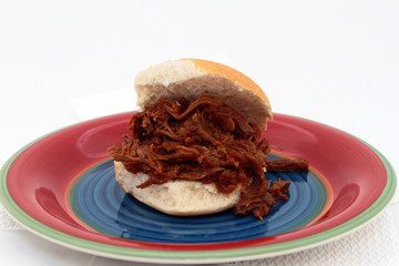 Shredded Beef Sandwich On Colorful Plate
