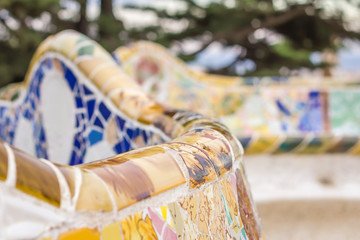 Colorful mosaic bench of park Guell in Barcelona