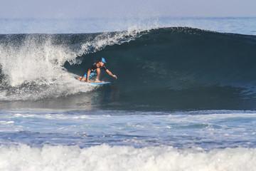 Surfer on Blue Ocean Wave.