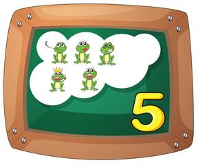A blackboard with five frogs