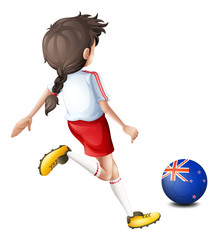 A lady kicking the ball with the flag of New Zealand