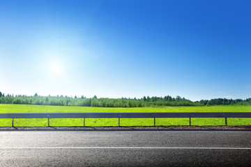 road and field of spring grass Wall mural