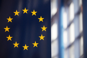 The EU flag; sunrays reflecting