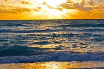 Wall Mural - Golden sunrise at ocean beach.