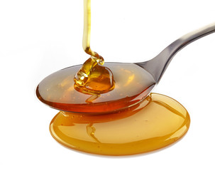 honey pouring into spoon