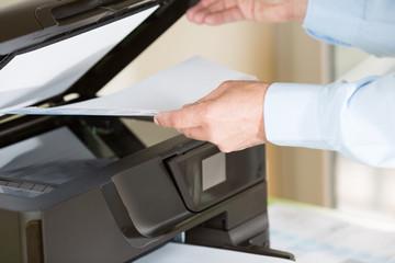 Man making a photocopy