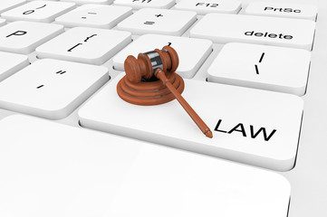 Extreme closeup Judge Gavel on a keyboard