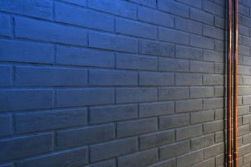 detail of gray brick wall with blue light