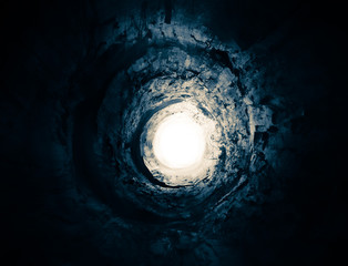 Mysterious blue tunnel to the light. Way to another world.