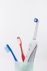 Electric and Manual Toothbrushes in One Cup Together