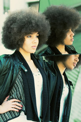 Beauty shot of a young, black woman with afro hair cut