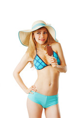 Young woman in bikini is eating an ice