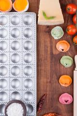 Multicolored ravioli on a wooden board